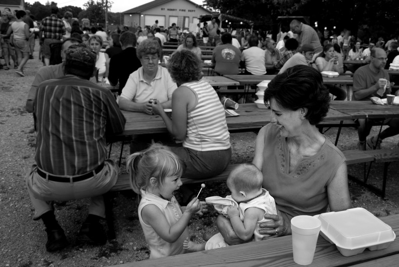 Monica Steckler, 2, of St. Henry, enjoyed a sucker at the Heinrichsdorf Fesitival in June but was willing to give a lick or two to Amber Tretter, a 3-month-old who was in the arms of her grandmother, Norma Blackgrove, of Huntingburg.
