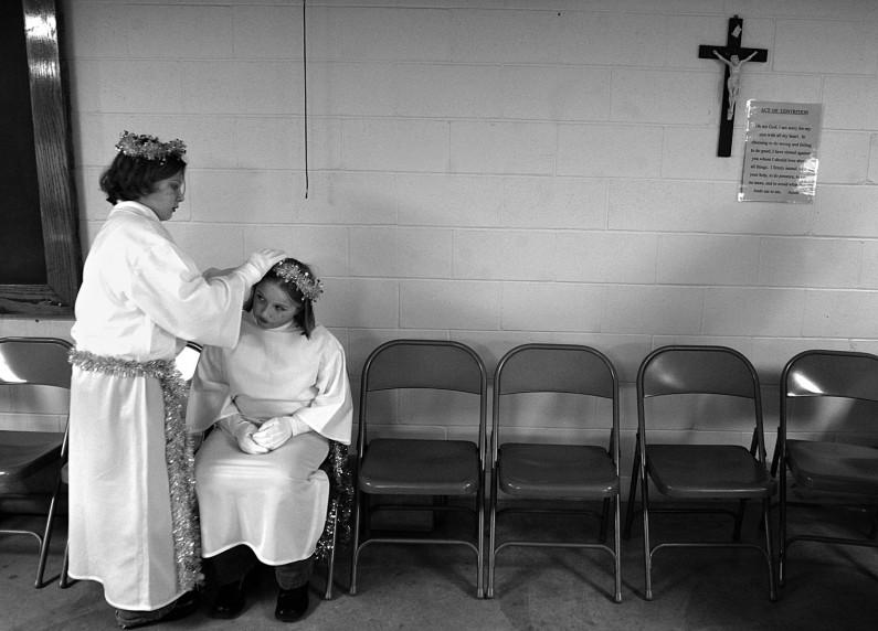 Beth Jochem, 11, helped her cousin, Kelli Jochem, 11, look like a presentable angel for last year's St. Henry Catholic Church live nativity pageant.