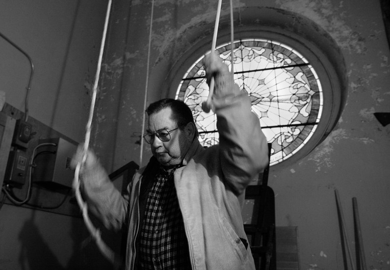 Bells sound from the St. Henry Church three times a day and when Floyd Schwinghammer, pictured, isn't available to sound the bells, his son, Tom, will pull the ropes.l