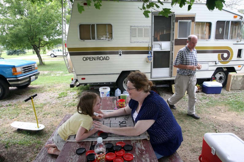 Kim and Rich Mattox with their 6-year-old daughter, Mariah, live in a camper at the Enchanted Shores campground in Peotone. Home is a 17-foot recreational vehicle and mesh dining tent at the private campground at which they will stay through the winter.