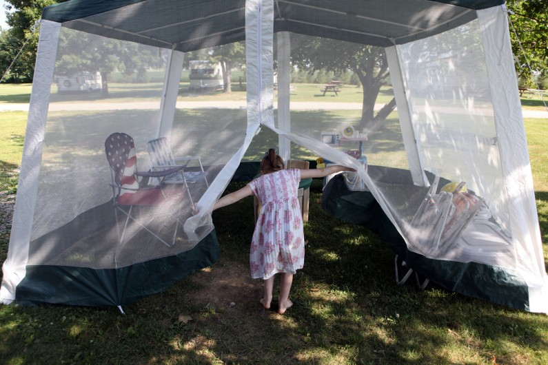 Mariah enters the family's mesh dining tent, which also serves as a playroom.