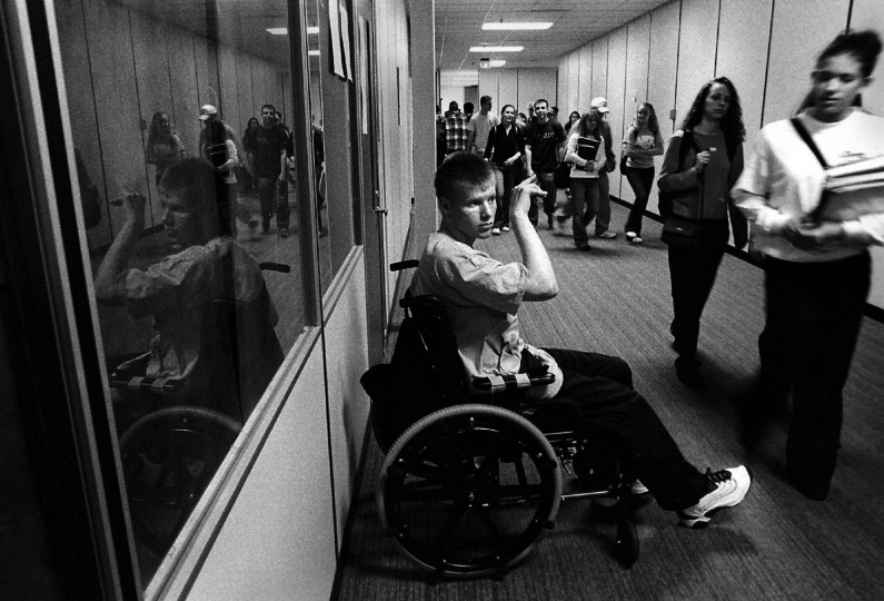 Between classes, Jason always asked to be wheeled to the hallway so he could wave to people he knew.