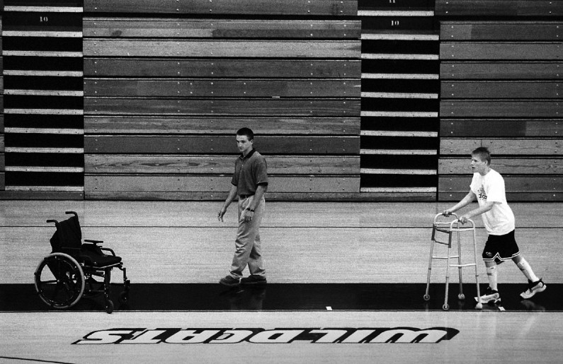 One hour of each day was spent doing some sort of physical therapy. Here, Matt rees, left, oversees jason walking around the Jasper High School gym.