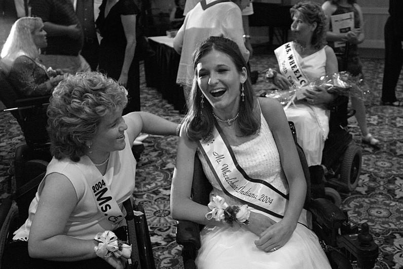 Competing in both the state and national wheelchair pageants gave Kelly an opportunity to meet other women in wheelchairs. Here, Craig and Ms. Wheelchair Iowa, Ami Dark, unwind after the national pageant.