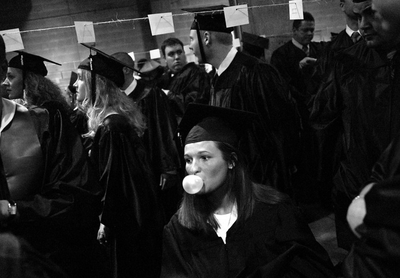 Kelly champed gum and blew bubbles while waiting backstage with fellow University of Southern Indiana graduates for the beginning of their commencement ceremony.
