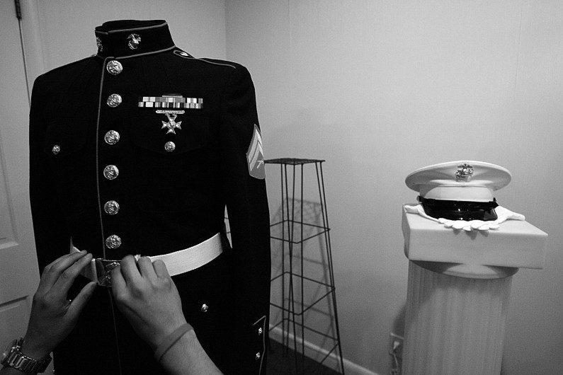 Sgt. Andre Valdez polished the buckel on a set of Eric's dress blues that was on display at the funeral home. Valdez and others spent nearly two hours on the display, making sure the buttons shined, the medals and ribbons were correctly spaced and accessories like his hat, gloves and sword were properly displayed.