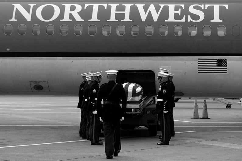 When the plane made its stop at the gate, it was emptied of its passengers and baggage before the ceremony that marked Lueken's return home.