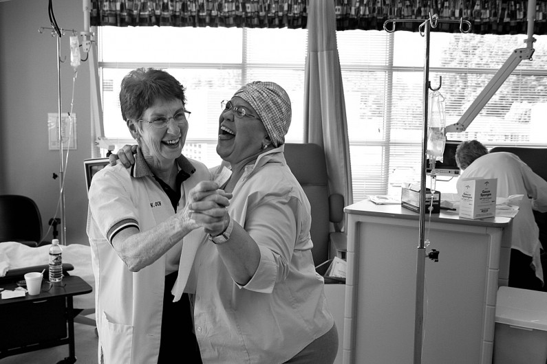 Marsha was upbeat throughout treatment at Memorial Hospital's Oncology Clinic and had the nurses, including Alice Kluesner, dancing on the day of her final treatment.