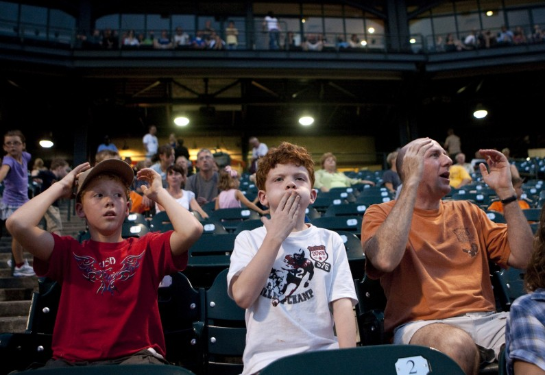 The Walgren family of Naperville, Corey, 10, left, Josh, 7 and their father Doug react to a missed opportunity by the Jackhammers, who left a runner stranded on base, during the second-inning of a game with the Kansas City T-Bones at Silver Cross Field in Joliet.