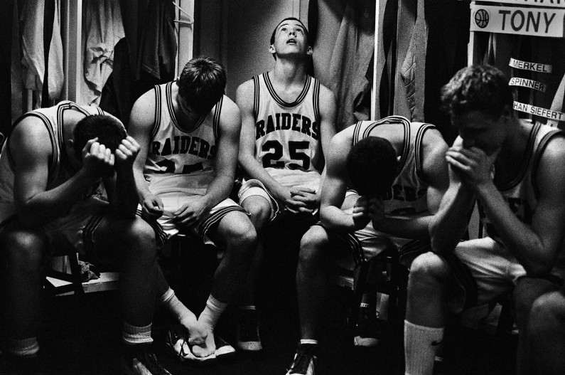 Southridge's Adam Bauernfiend, center, stared at the ceiling as he and his teammates listened to coach Tom Hawworth's words of consolation after a 75-52 loss to Perry Central in the sectional opener at Huntingburg. The Raiders ended the season with just three wins.