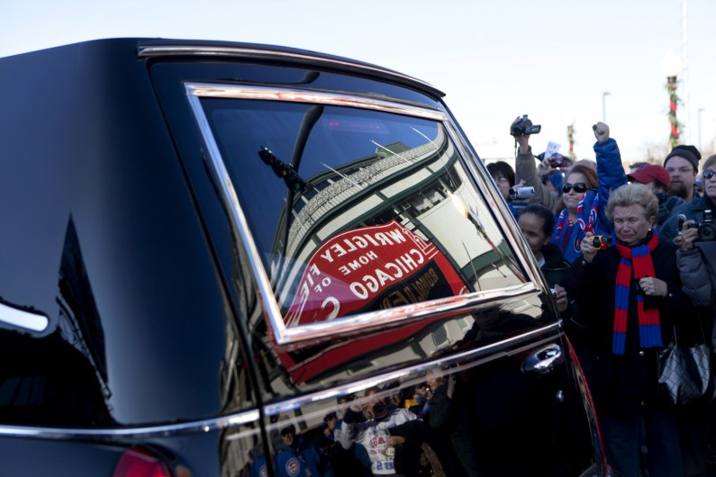 Ron Santo's beloved Wrigley Field is reflected in the window of the hearse carrying his body. Following Santo's funeral, his hearse processed through the streets of Chicago, including a loop around Wrigley, where fans waved, cried and gave him one last cheer.